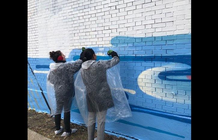 Volunteers assisting with the mural